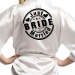 Personalised Satin Robe available in the colours, badge style motif printed with your wedding details,  Just Married Design.